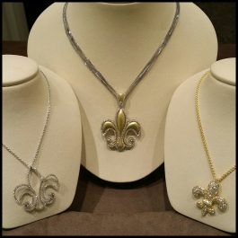 "Aucoin Hart's own brand of ""Fleur-de-Lis"" jewelry"