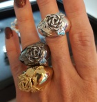 Rose rings coated in silver, black rhodium, and gold by Léia Sgro